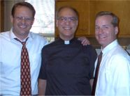 Pete Ferrara with Fr. Eduard Perrone and Joe Maher after Father Felicien Houndjame was acquitted